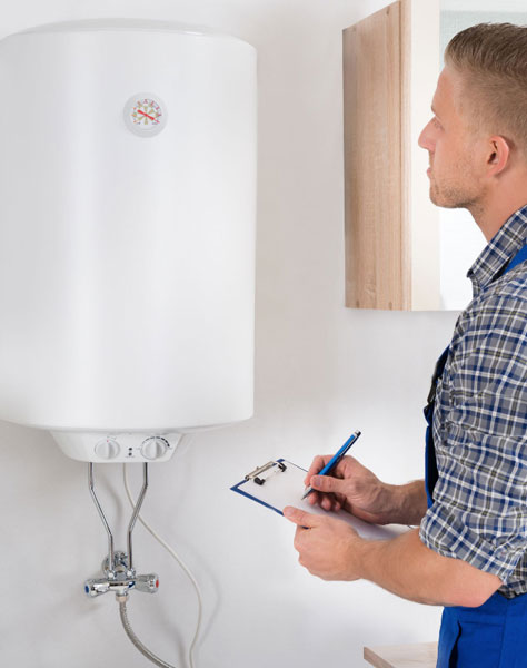 An image of a plumber doing an inspection of a water heater.